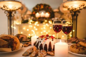 a table full of sugary treats and wine