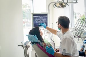 Emergency dentist treating patient
