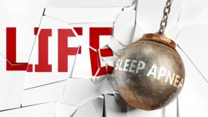 "a wrecking ball with the words ""sleep apnea"" crashing into a wall that reads ""LIFE"""