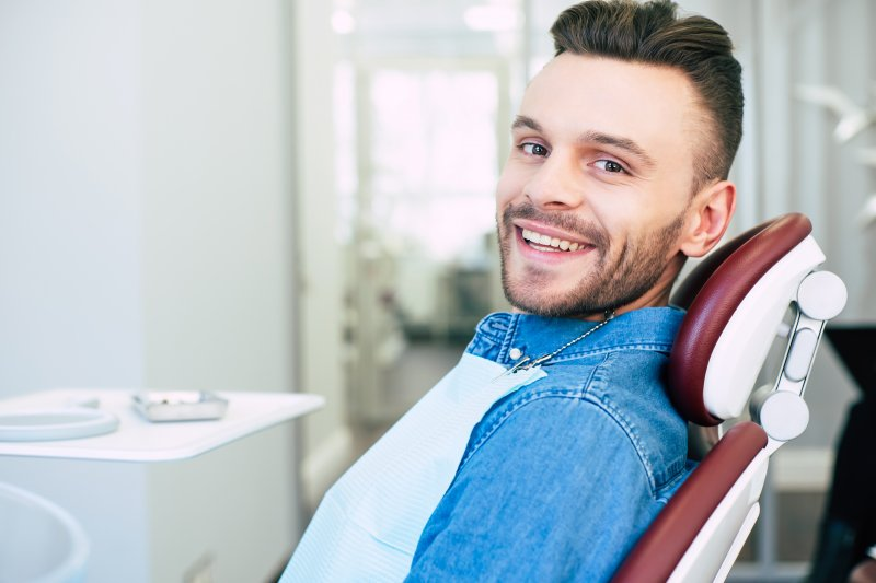 Man smiling at routine dental appointment