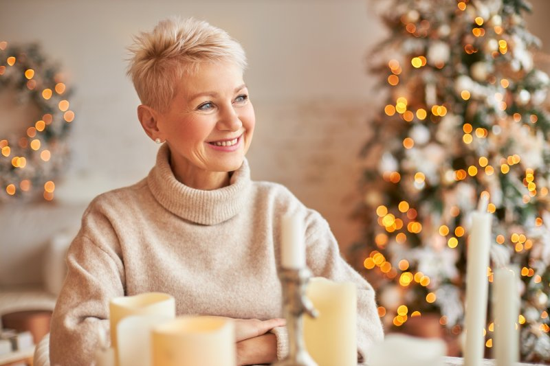 Woman smiling in festive living room