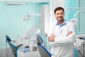 dentist smiling about to give a dental checkup